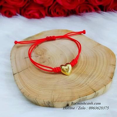 Vòng tay trái tim vàng 10k tết dây chỉ đỏ LTNU219